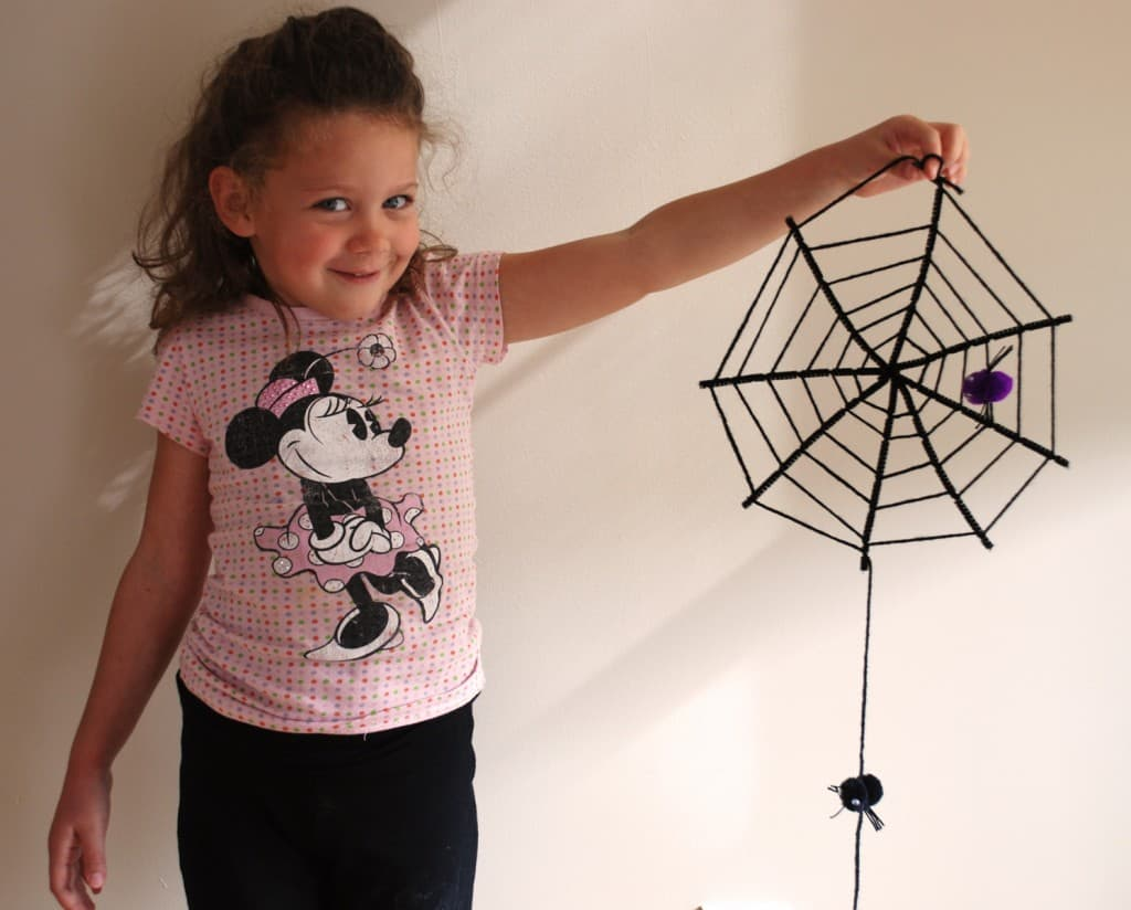 Pipe cleaner spider webs with hanging spiders