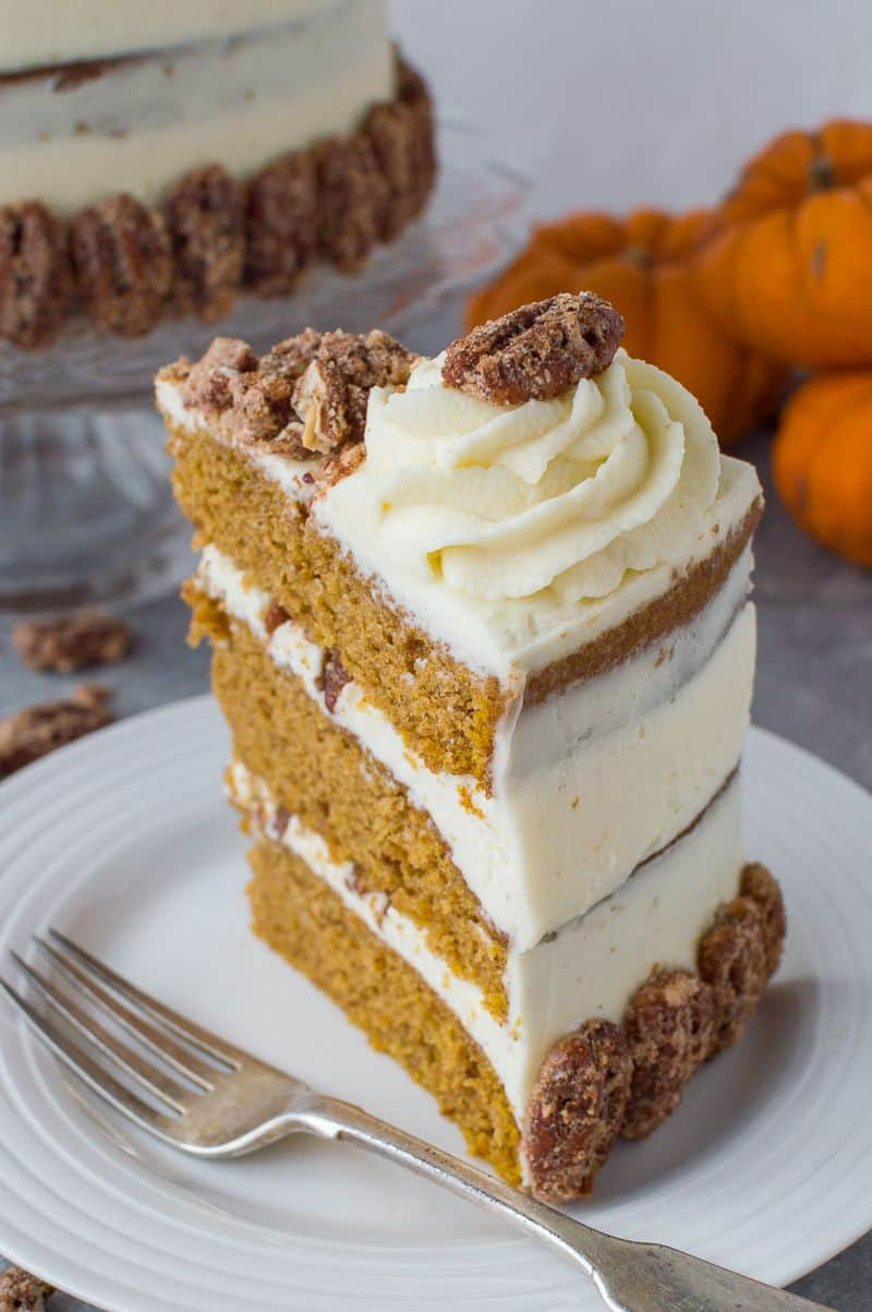 Pumpkin layer cake with mascarpone cream and sugared pecans for halloween fal