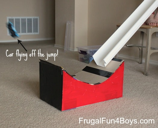 Rain gutter and cardboard box toy car jump