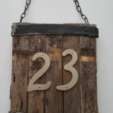 Rustic hanging wooden sign