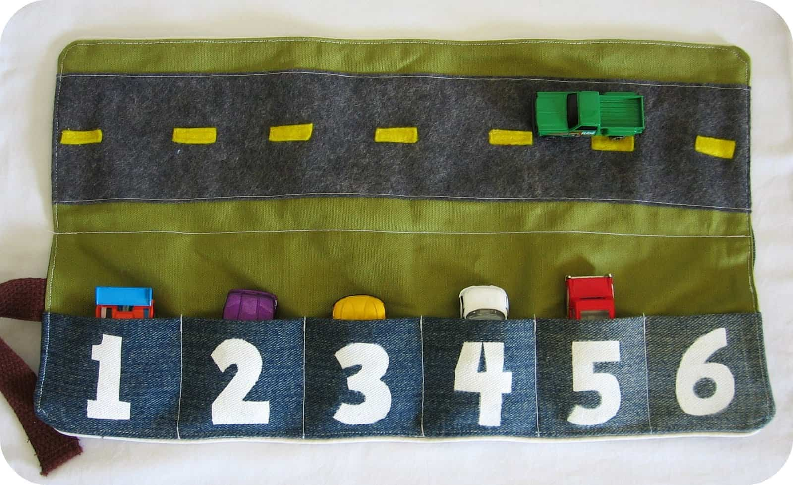 Toy card caddy with numbers and a road