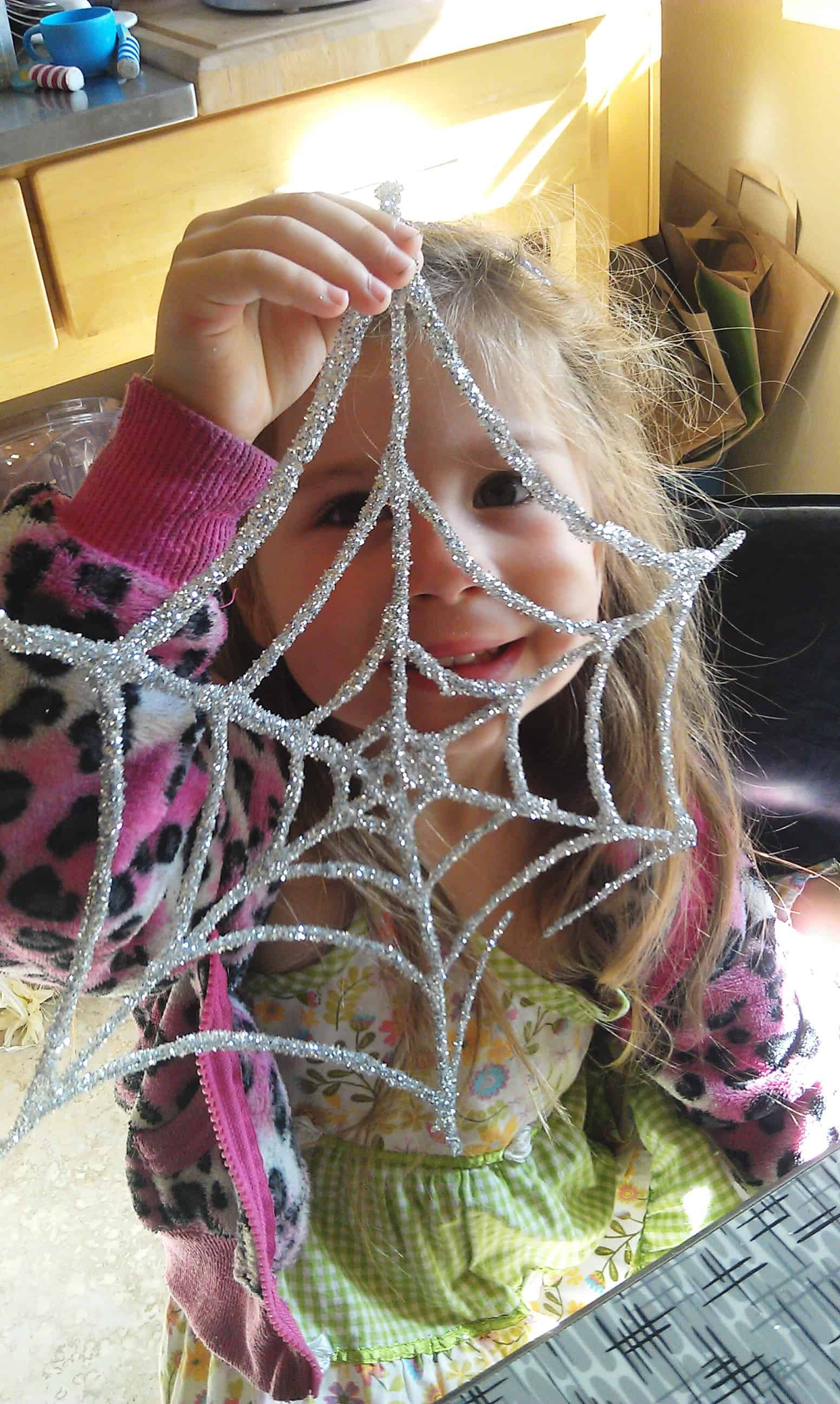 White glue and loose glitter spider webs