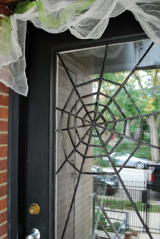 Diy halloween front door decoration subtle spiderwebs 1