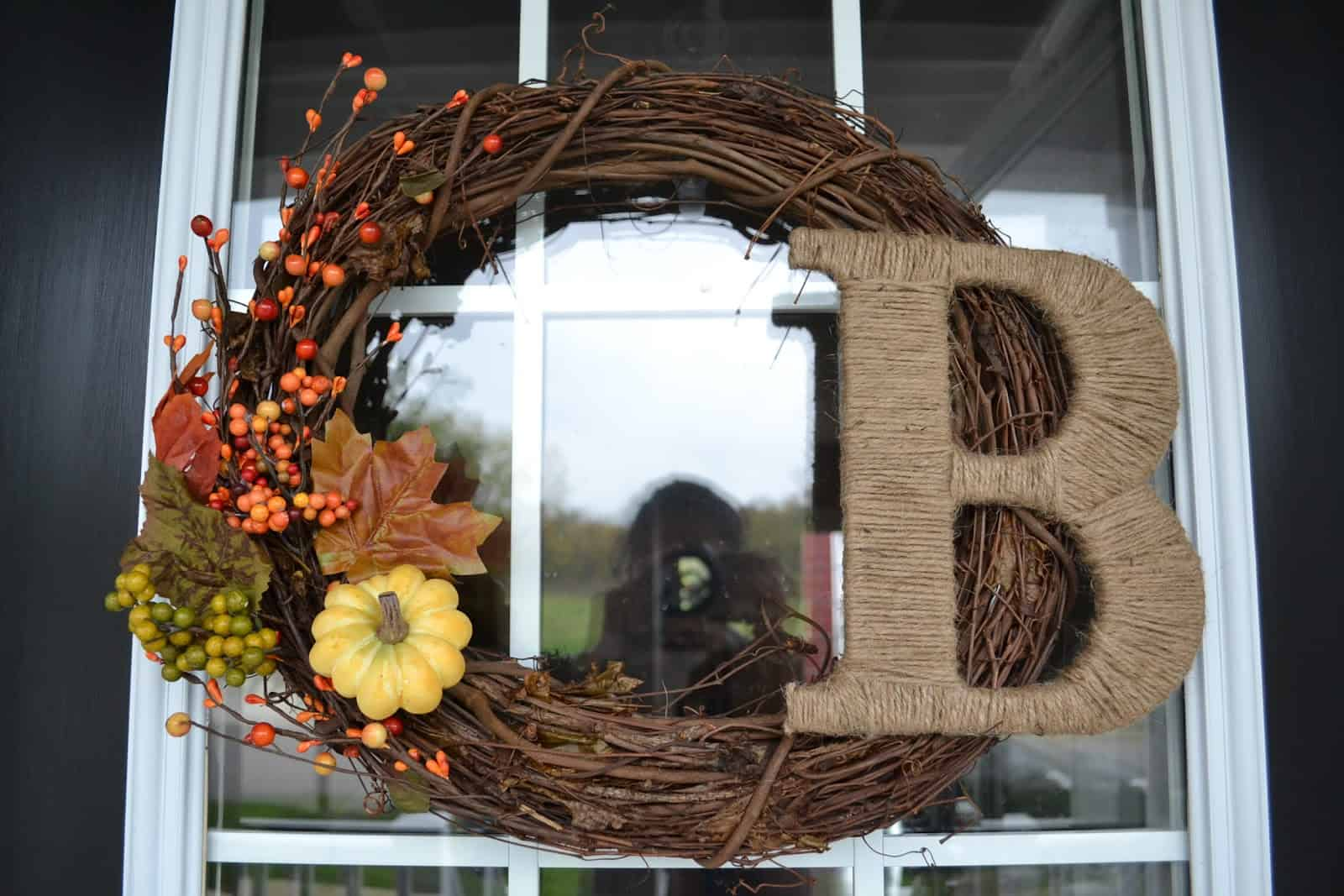 Berries and a burlap string wrapped monogram