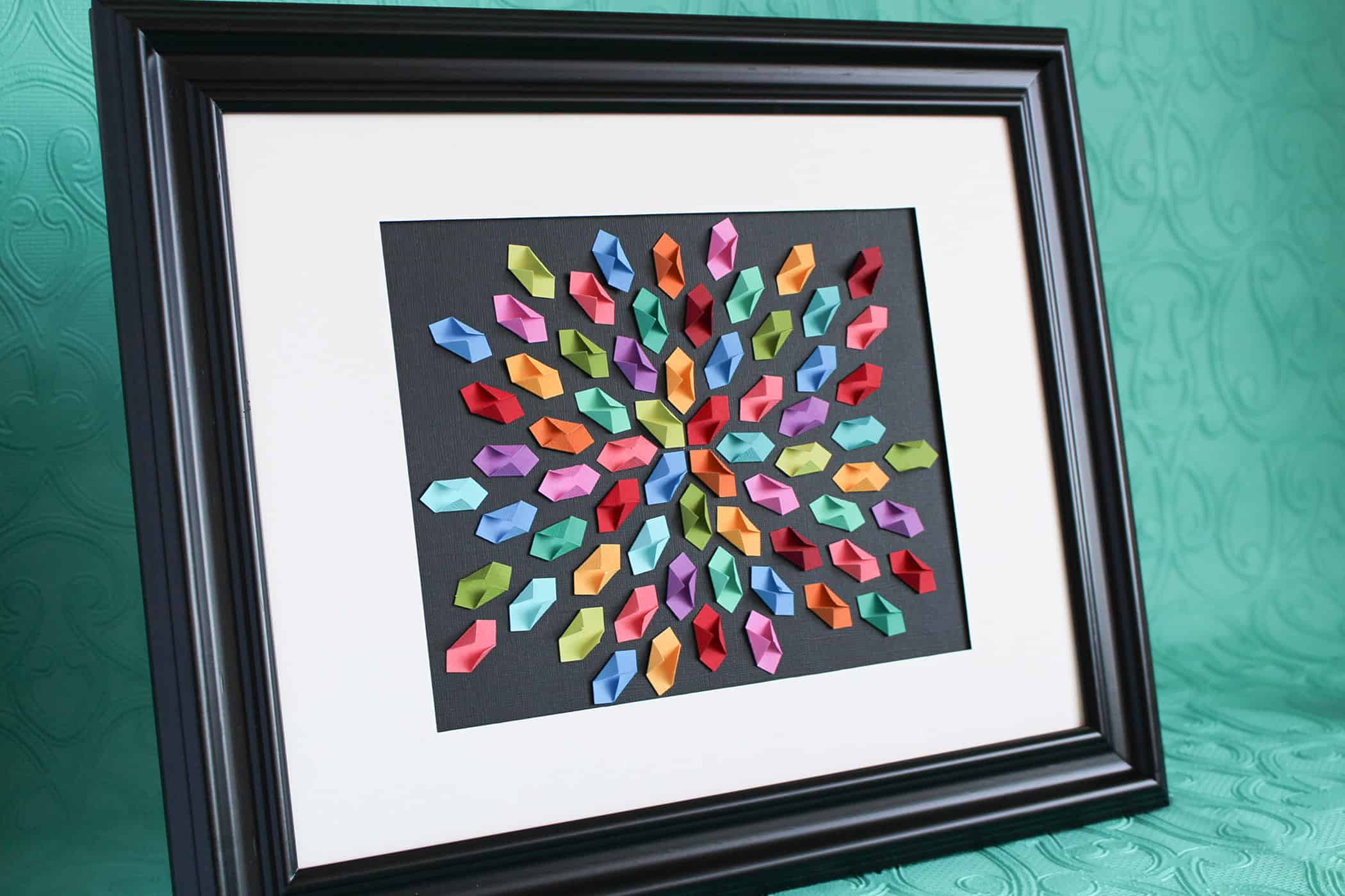 Colourful folded paper kaleidoscope art