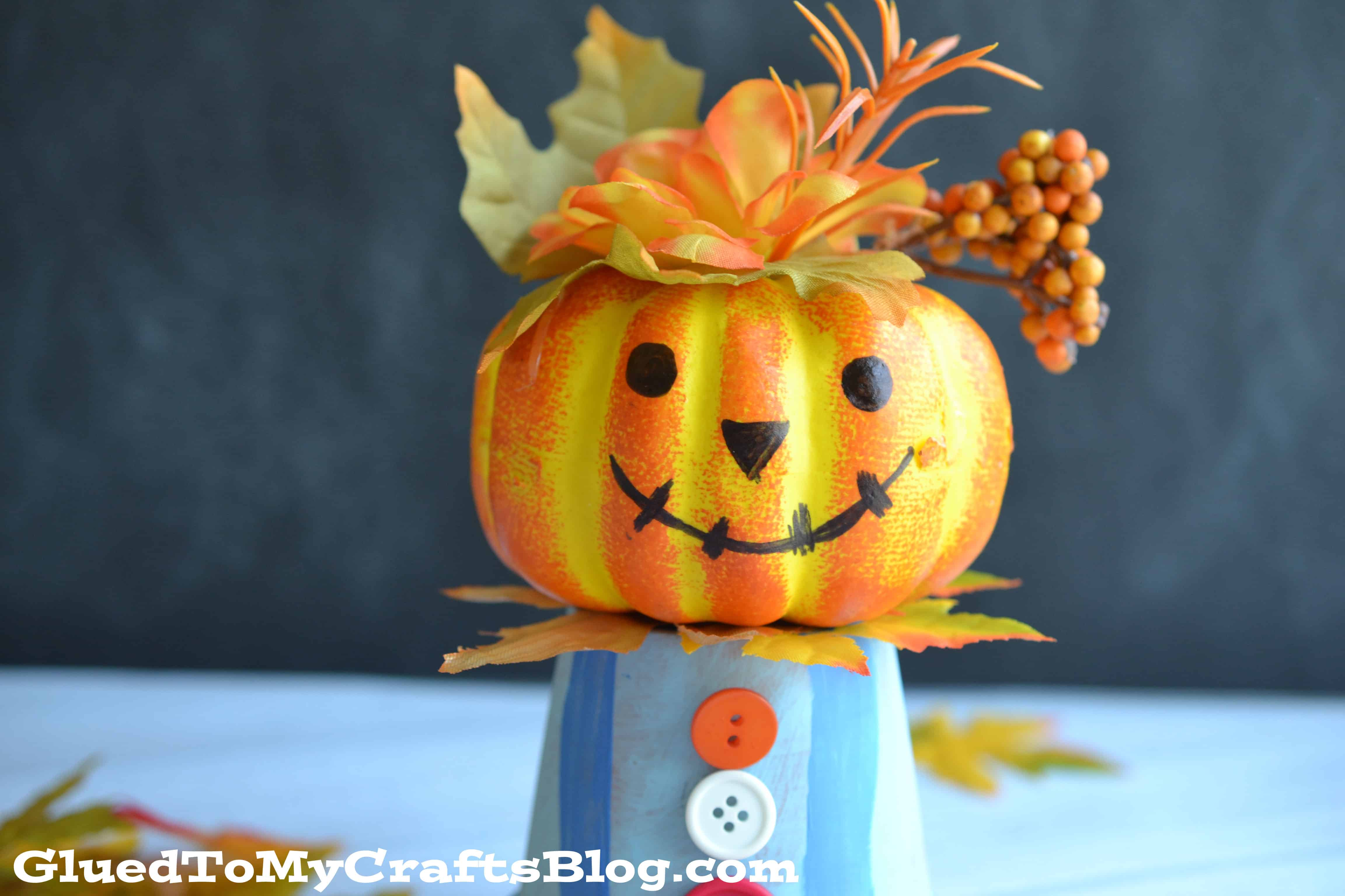 Mini pumpkin and buttons scarecrow