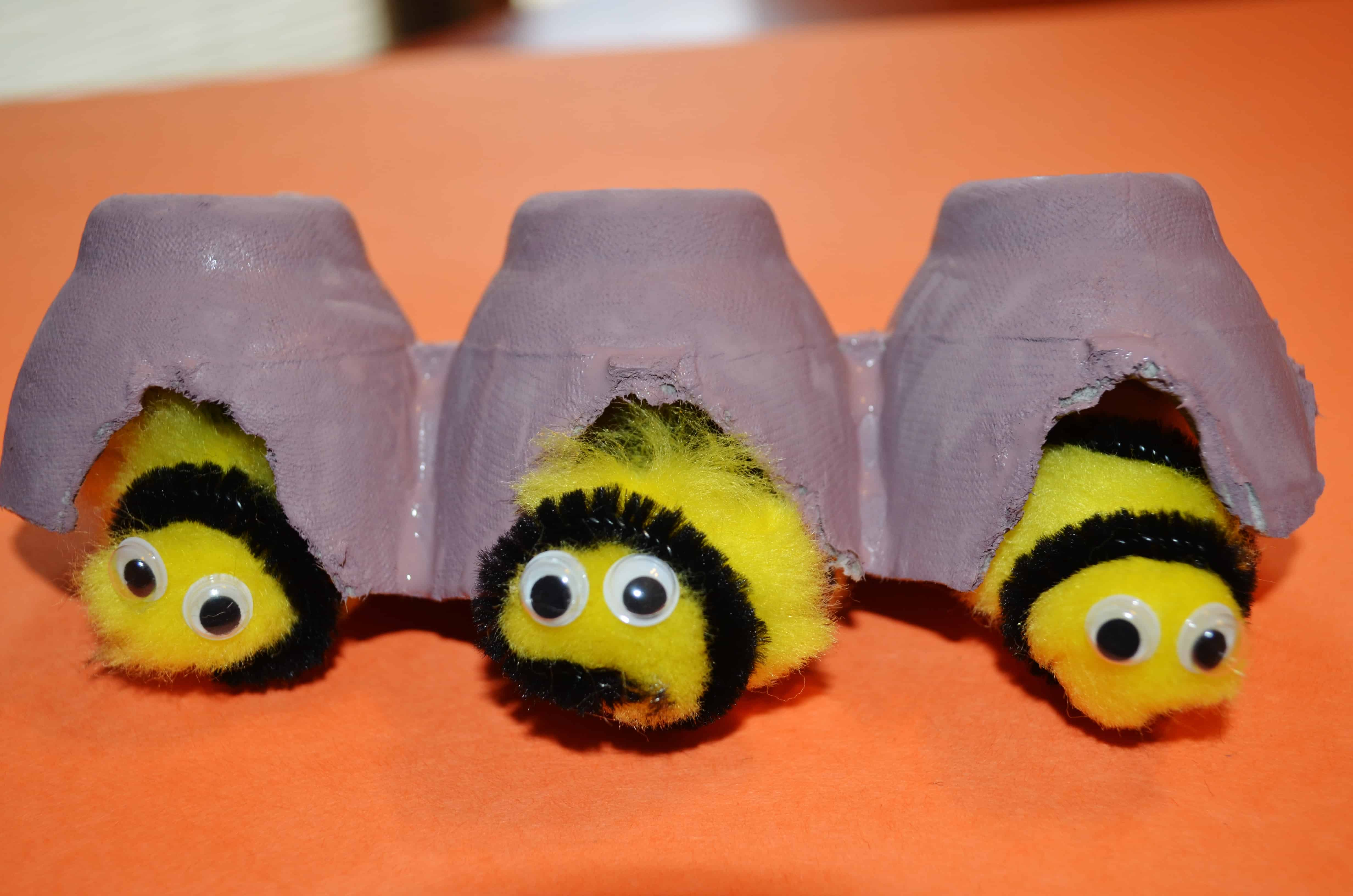 Pom pom bees with egg carton hives