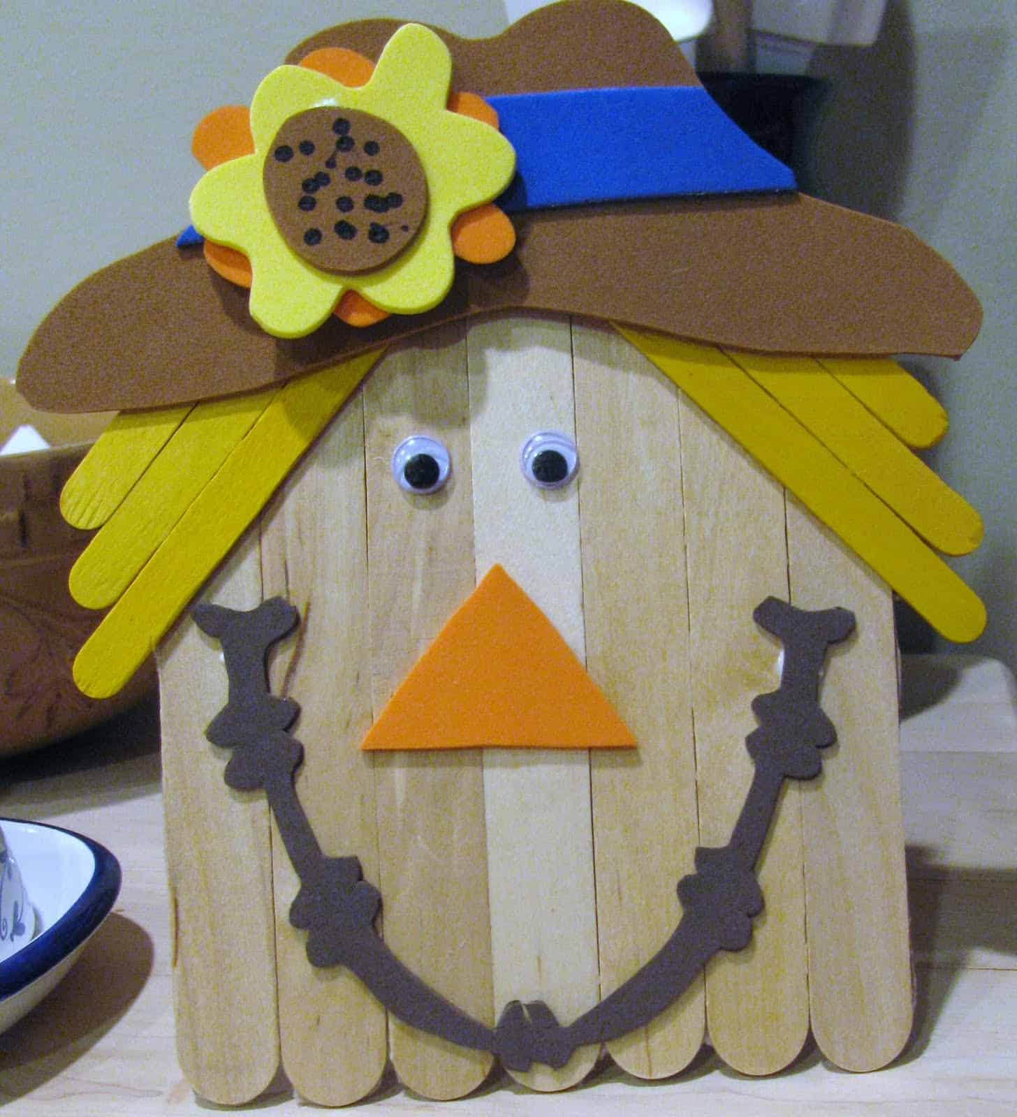 Popsicle stick and foam paper scarecrows