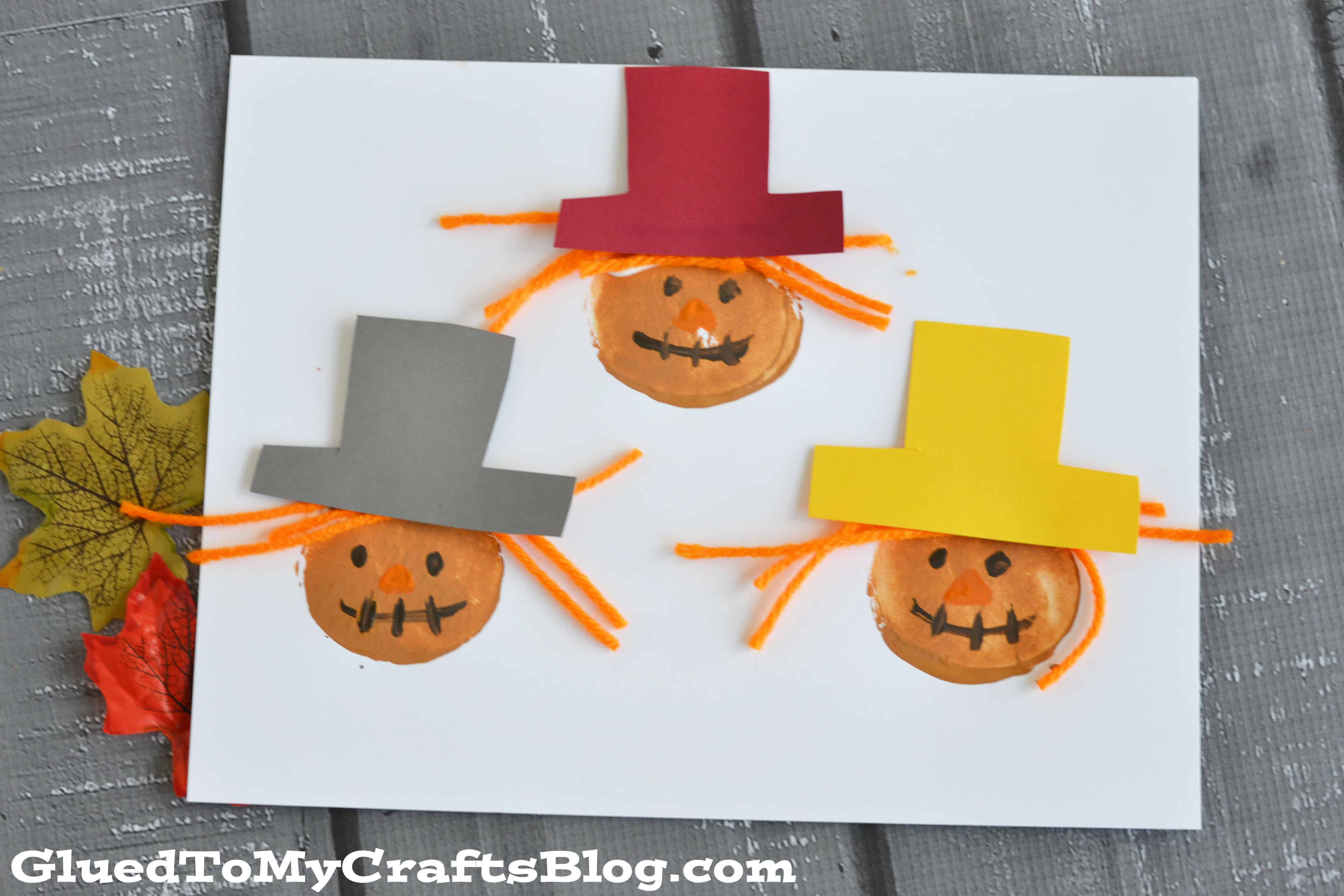 Potato stamp and yarn scarecrows
