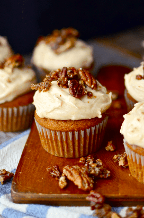 Pumpkin cupcakes with browned butter cream cheese frosting and candied pecans