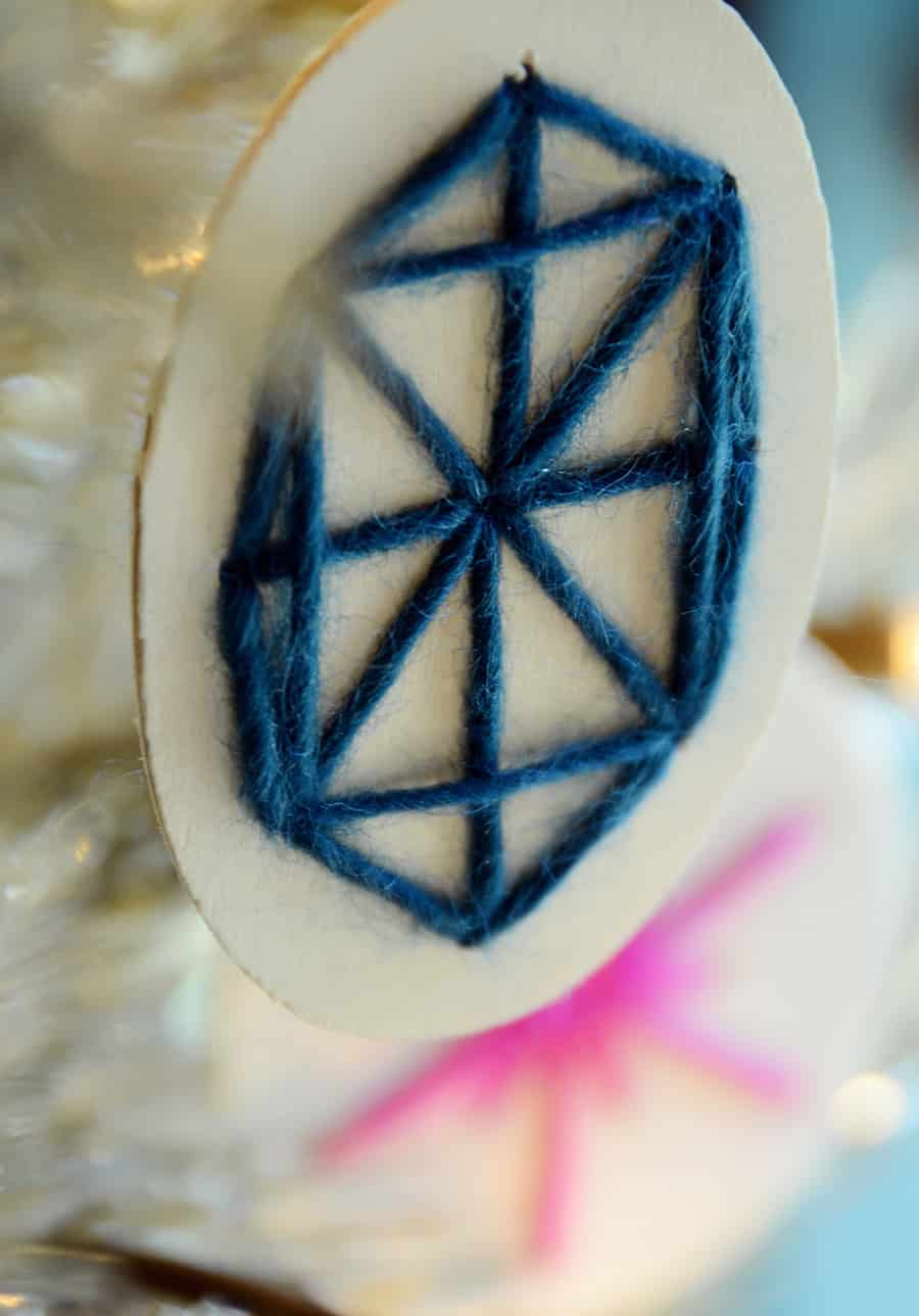 Stitched wooden ornament 15