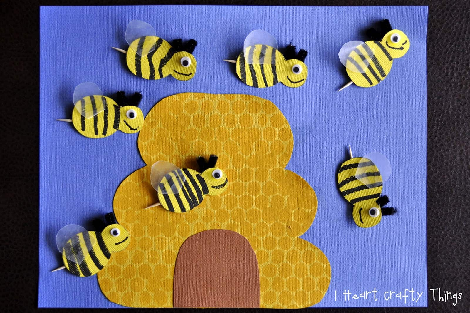 Toothpick and construction paper bees with a hive