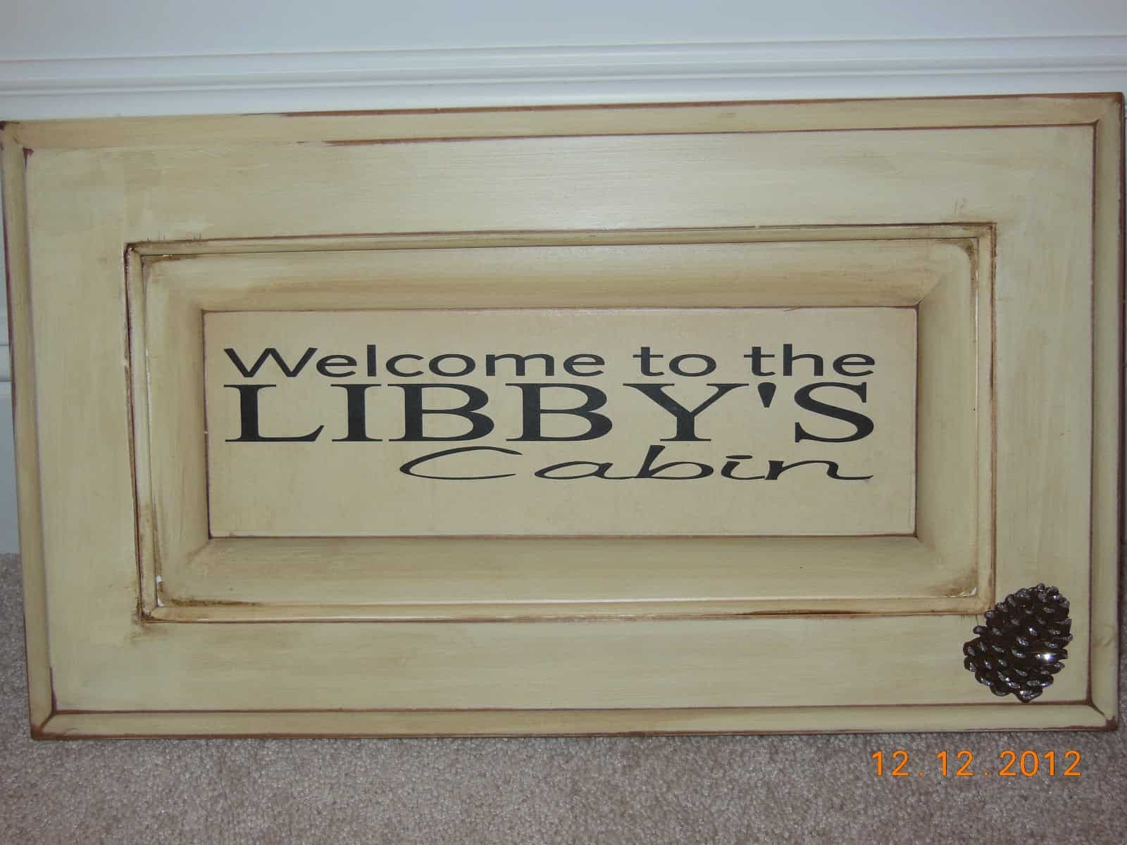 Upcycled cabinet door welcome sign