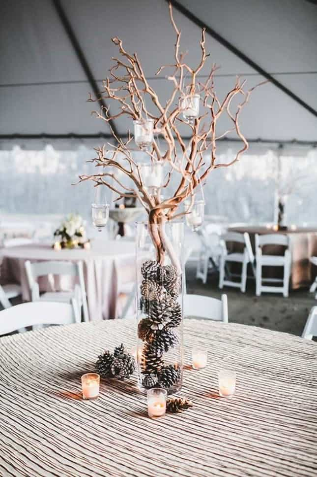 Pinecone and twig centerpieces for winter wedding