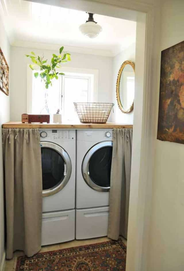Small laundry room with countertop