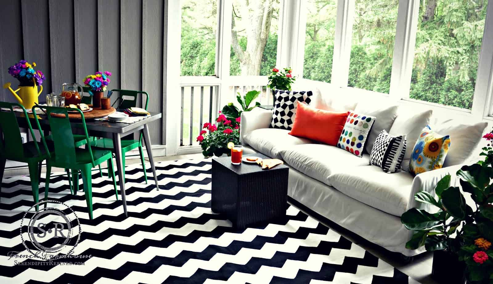 Black and white geometric outdoor living room screened porch