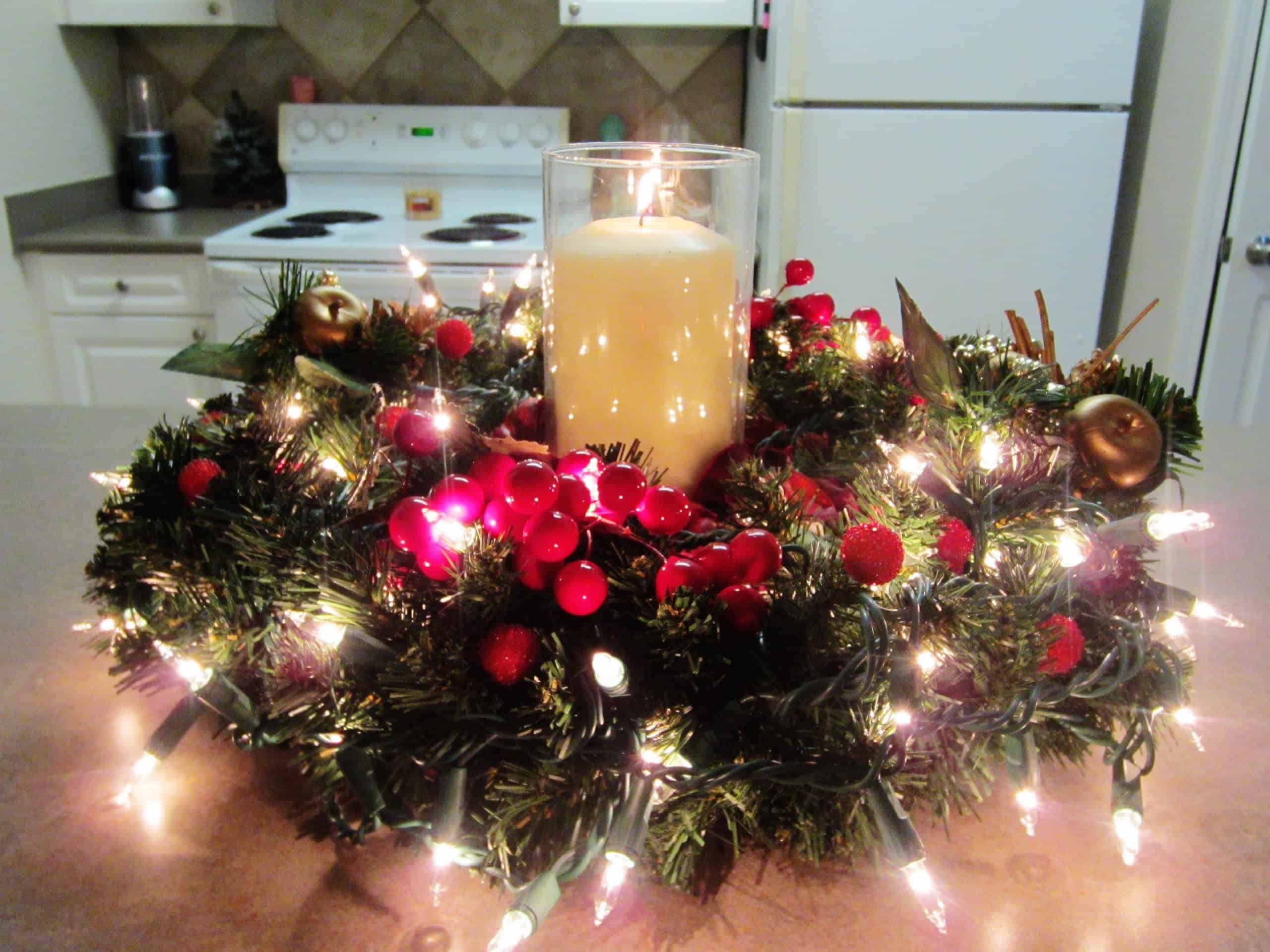 Candle and christmas wreath centrepiece