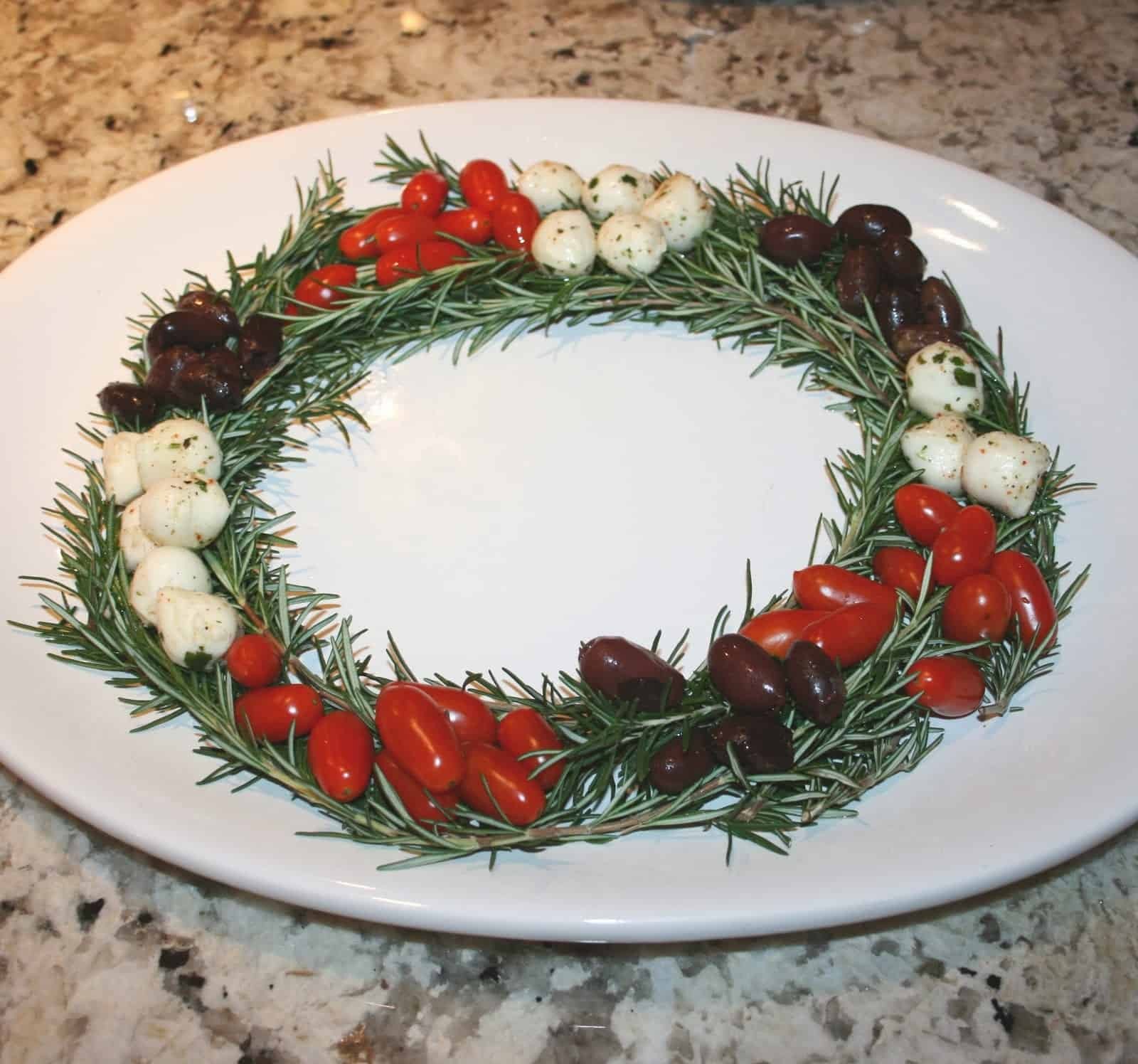 Caprese salad and black olive rosemary wreath