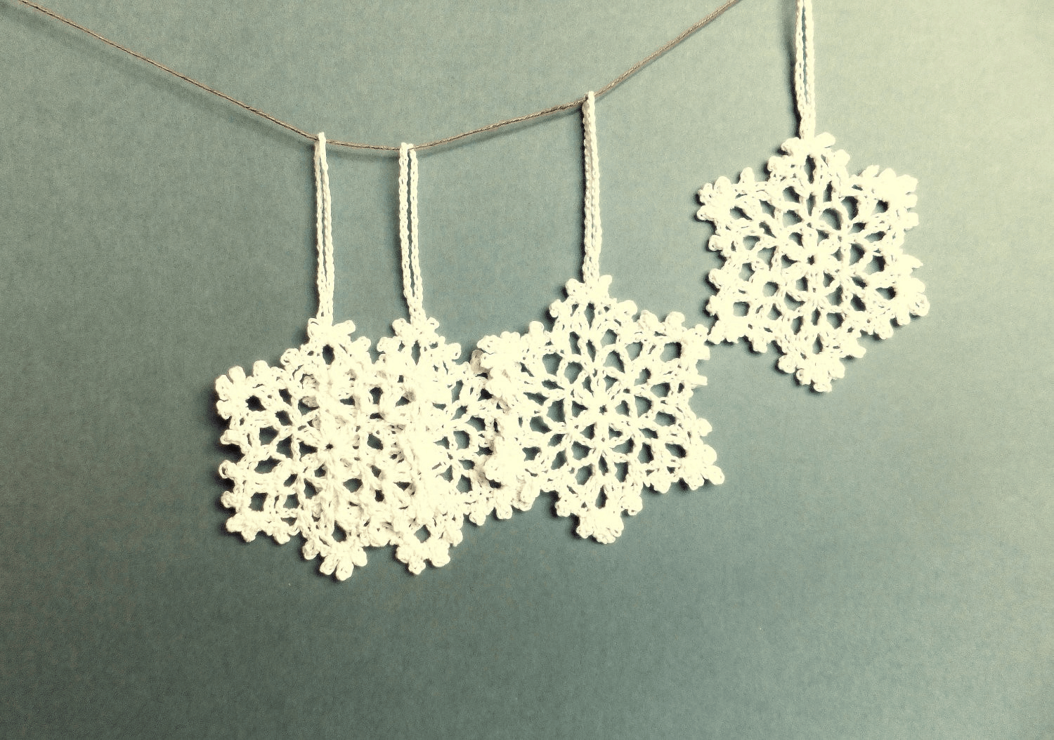 Finely croceted snowflake ornaments