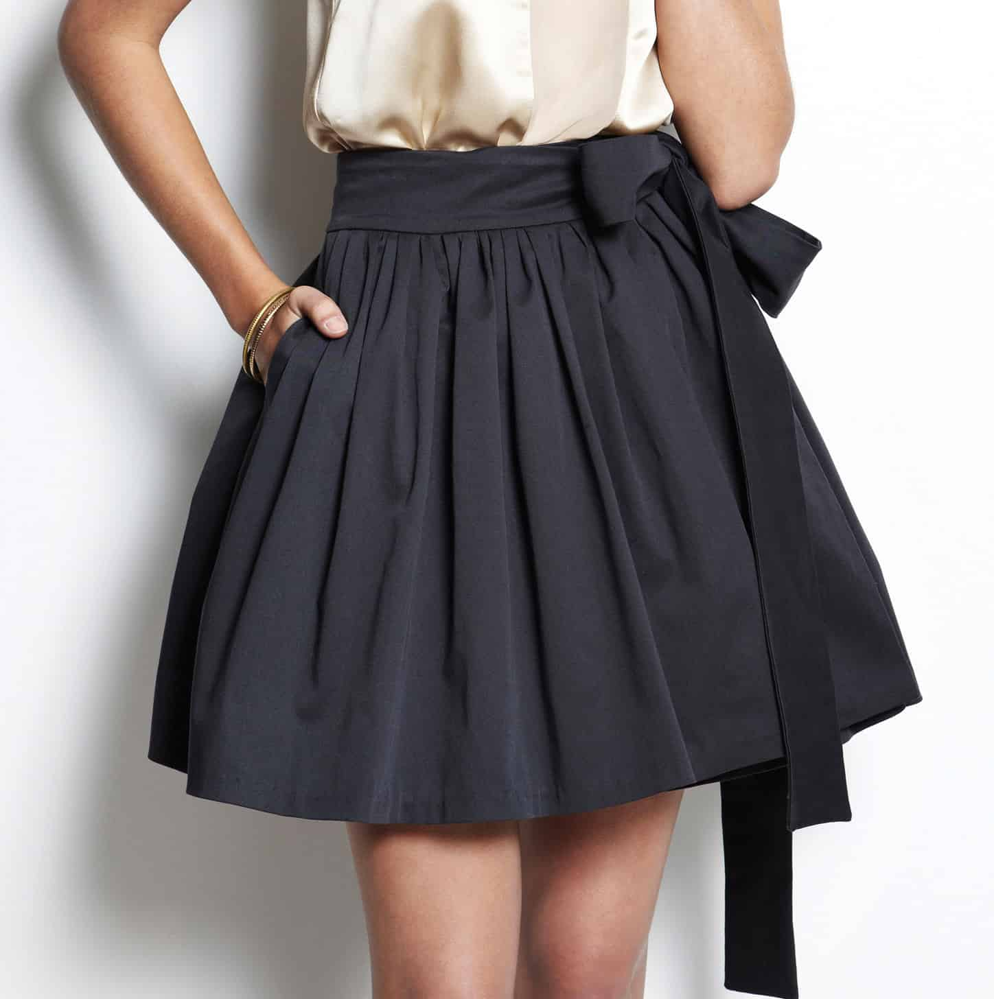 Pleated skirt with a ribbon tie waist