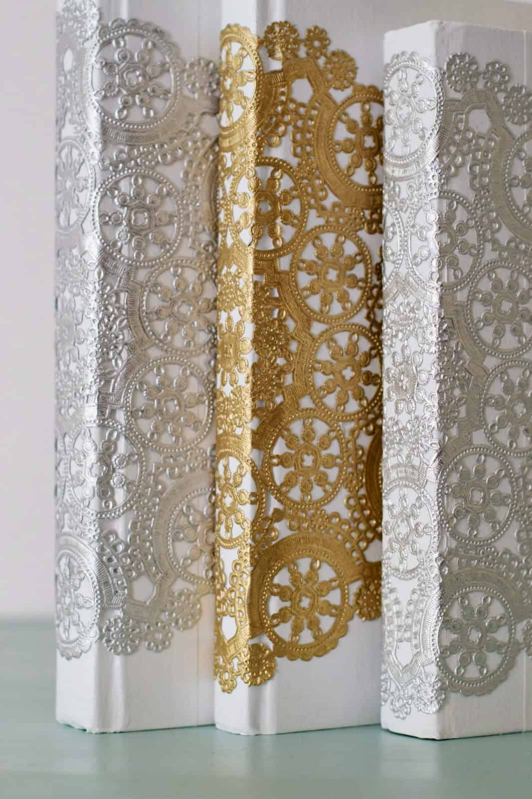 Silver and gold paper lace books