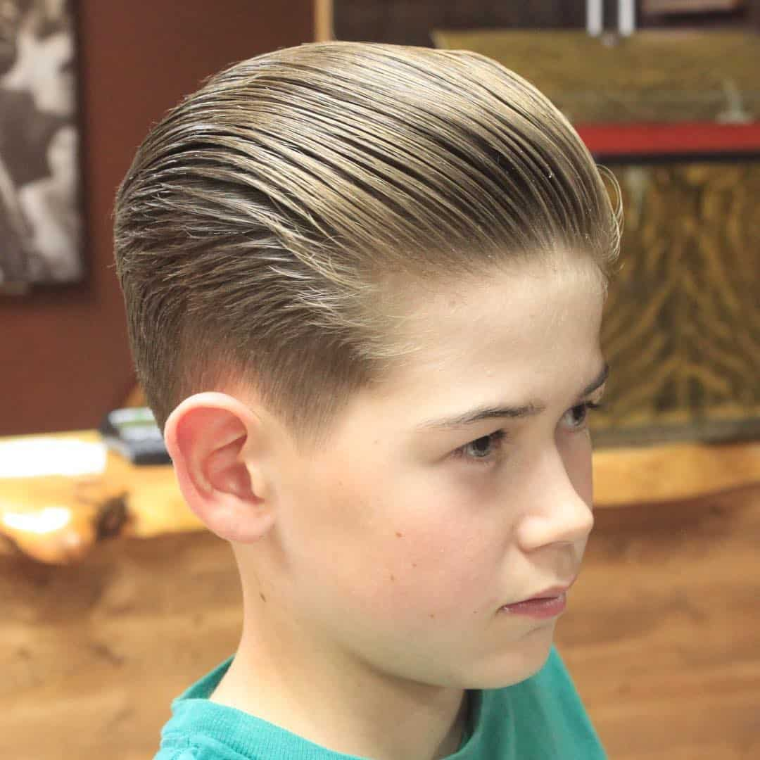 Little boy slicked back vintage haircut