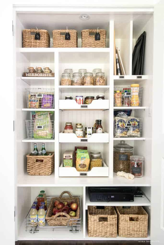 Add woven baskets to organized kitchen pantry