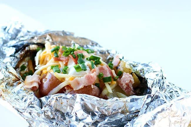 Campfire grilled loaded baked potatoes
