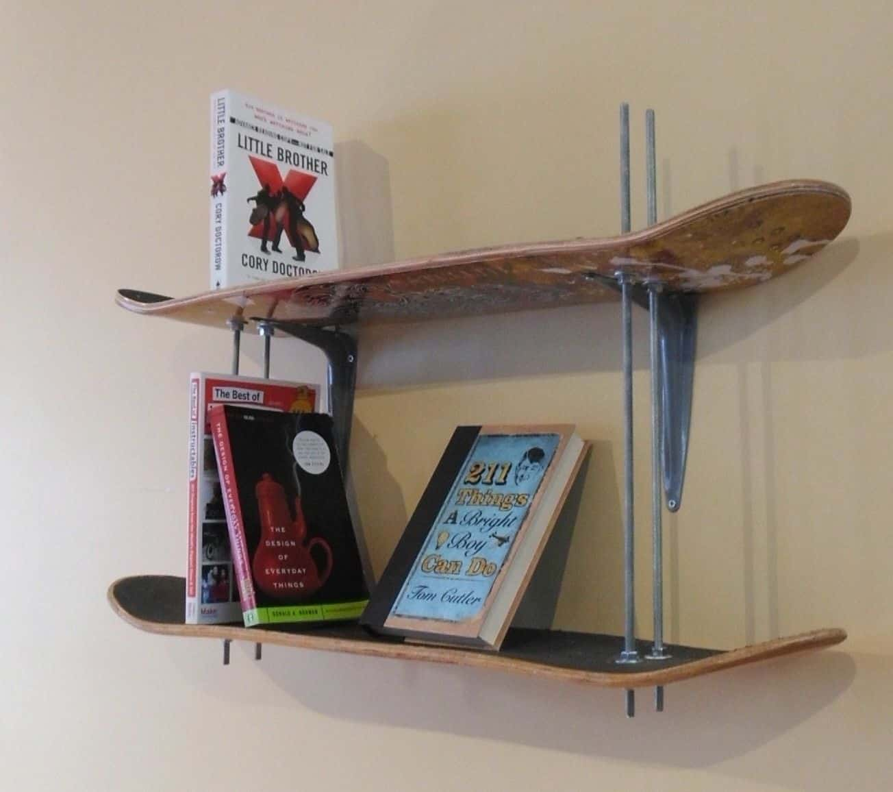 15 cool crafts made with upcycled skateboards dual level diy skateboard wall shelf solutioingenieria Choice Image
