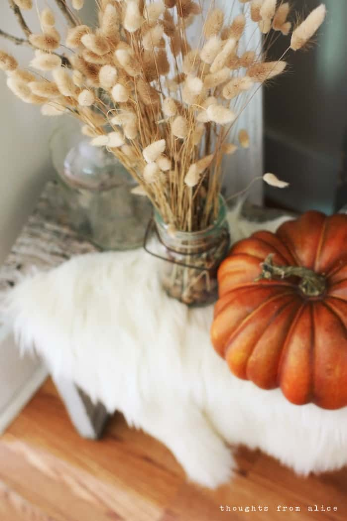 Faux fur rustic bench fall display