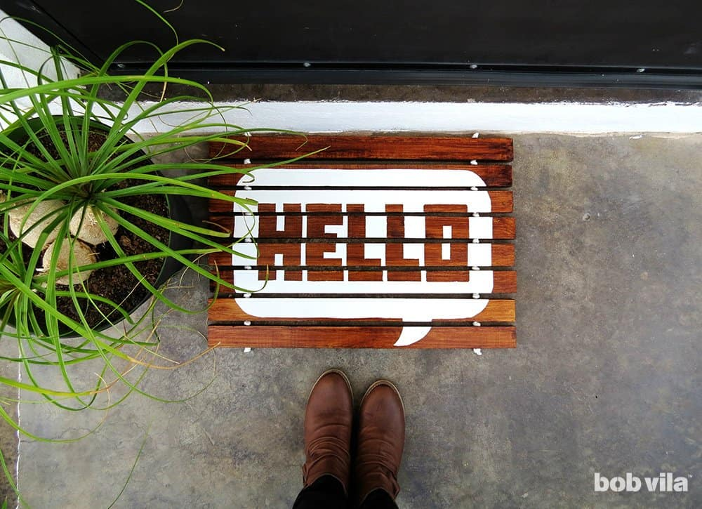 Wooden slat welcome mat