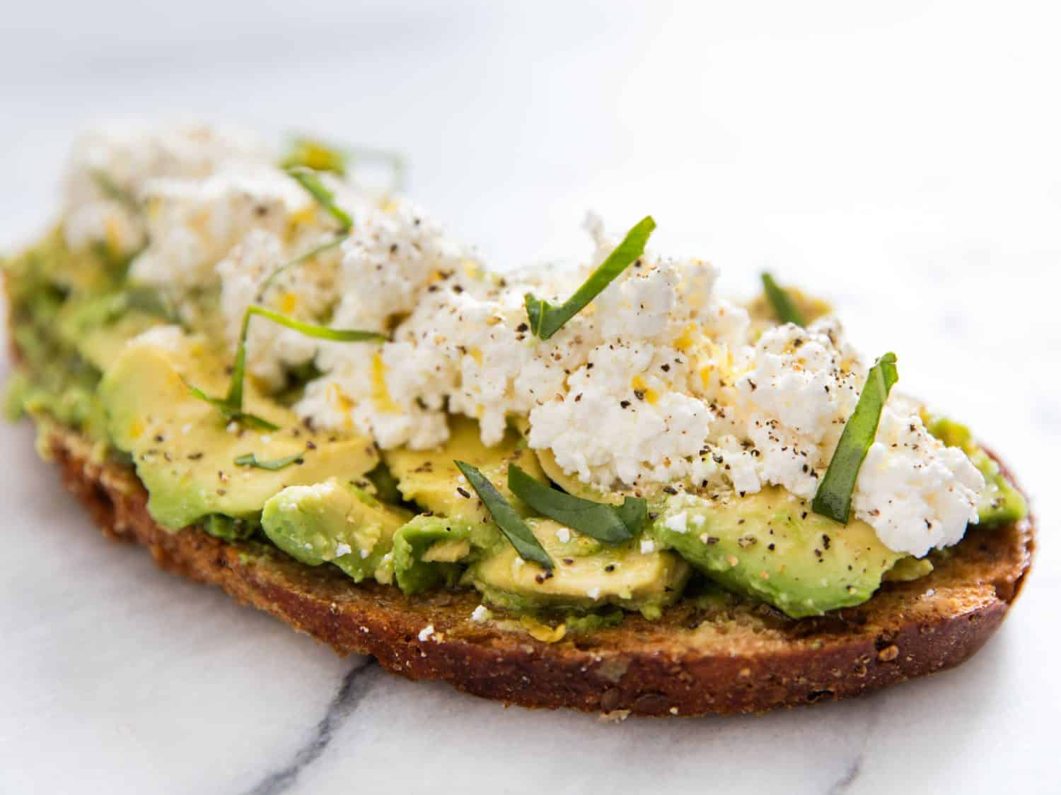 Avocado toast with ricotta cheese and olive oil