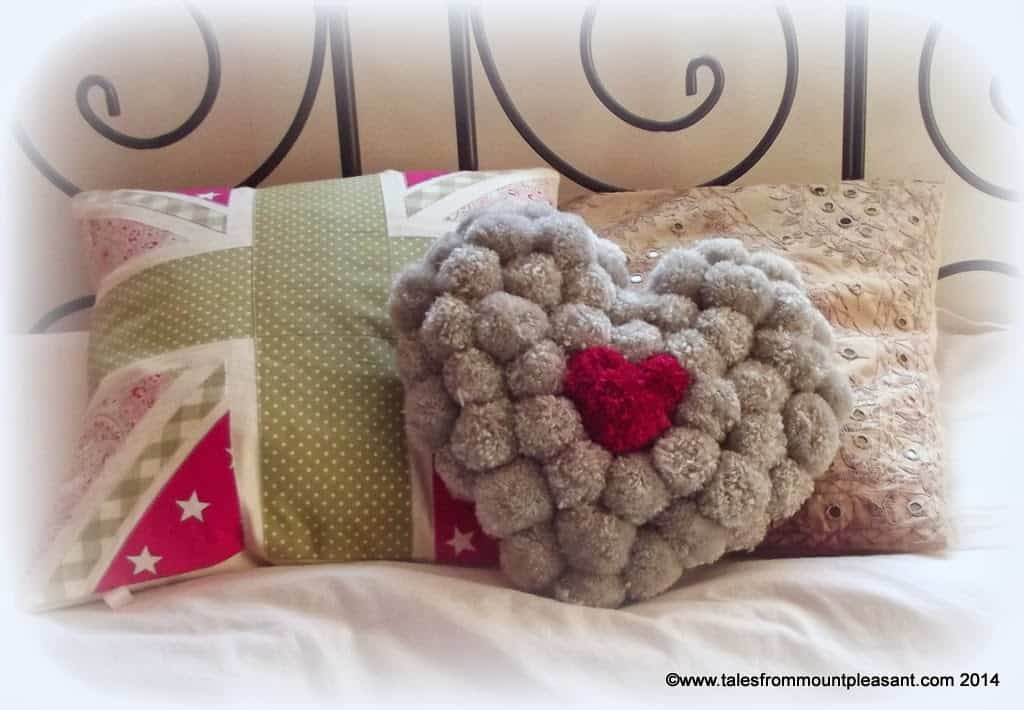 Colourful pom pom heart pillow