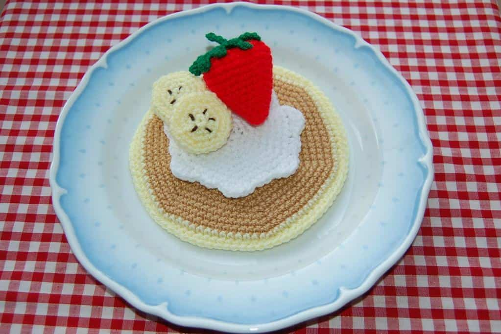 Crocheted fruit topped pancakes
