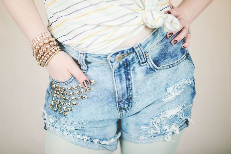 Distressed cut offs with studs