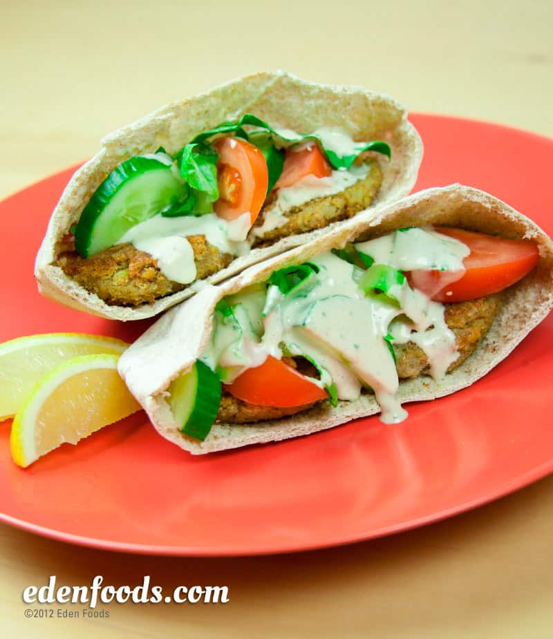 Falafel pita with tahini, cucumber, and tomato