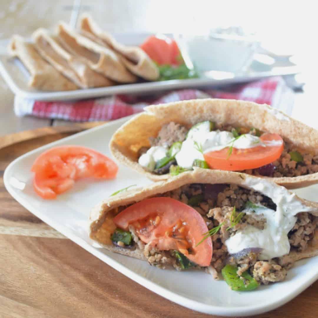 Ground pork and yogurt sauce greek pitas