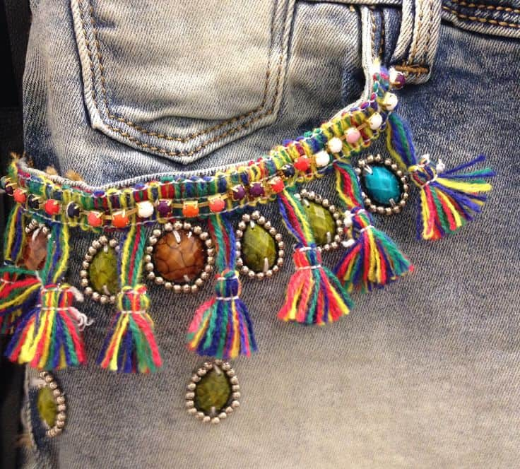Necklace and tassel embellished jean pockets