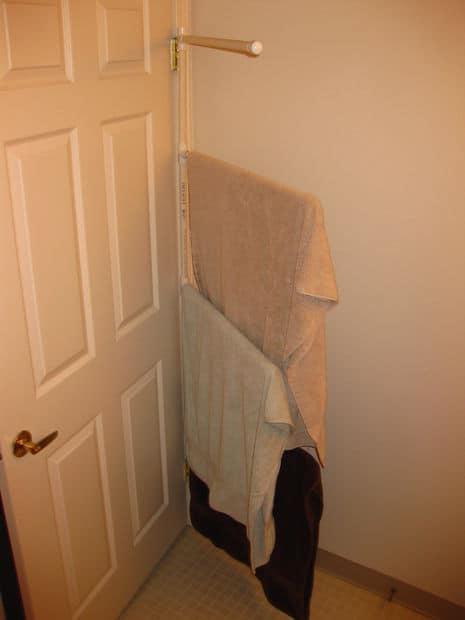 Pvc pipe towel hanger behind the door