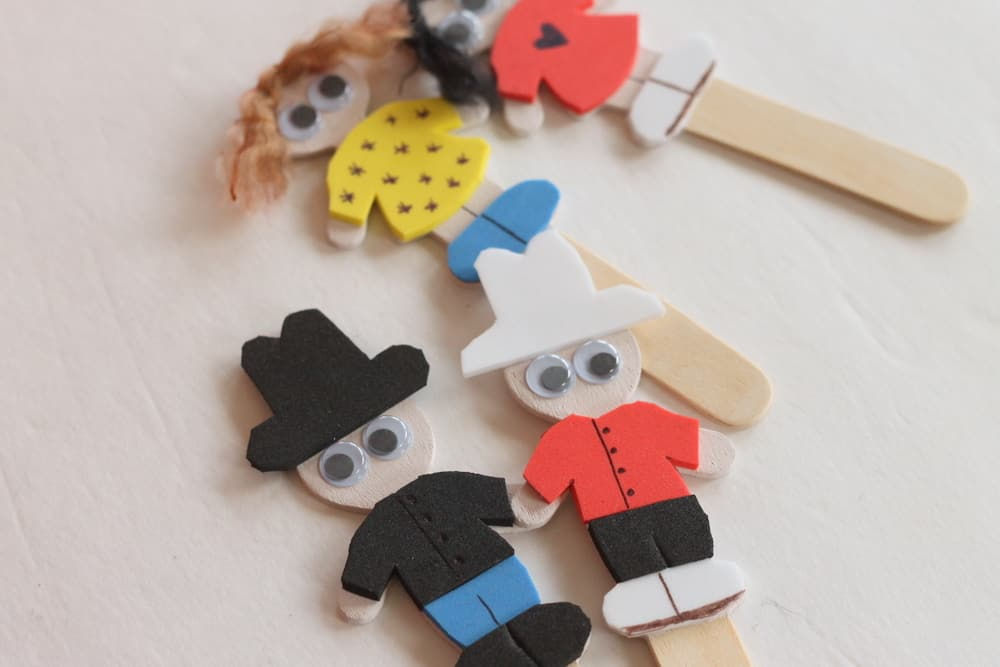 Popsicle stick and foam puppets with a puppet theatre