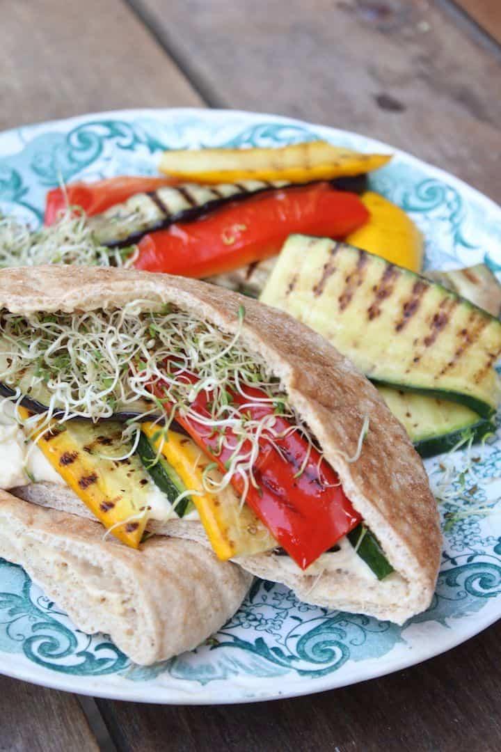 Vegetarian grilled veggie and hummus pita with alfalfa