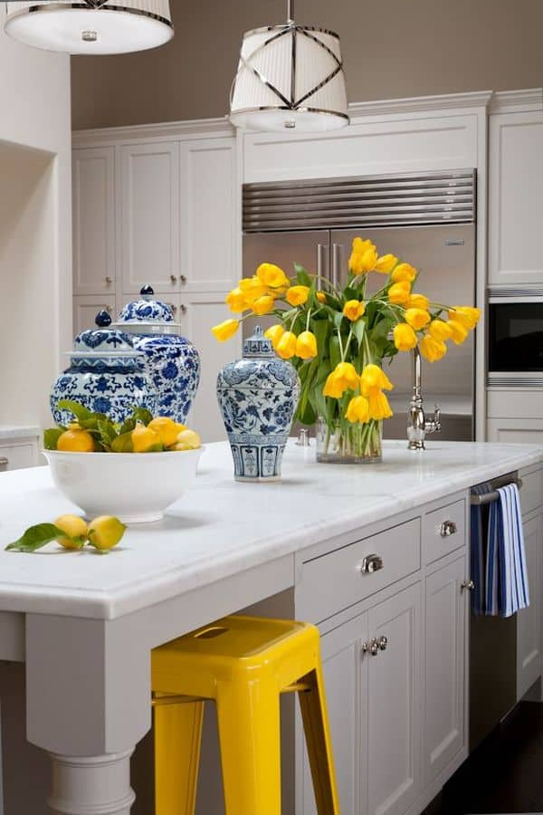 Yellow accents in a white kitchen