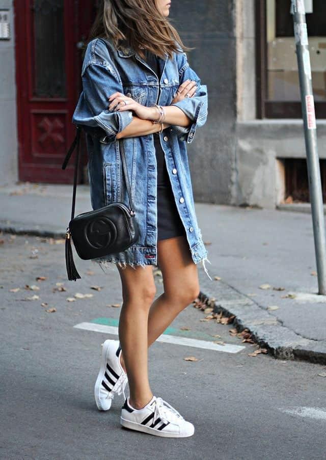 Oversized jean jacket with mini skirt