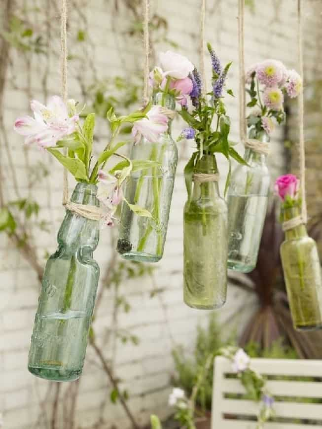 Flowers hanging bottle vases