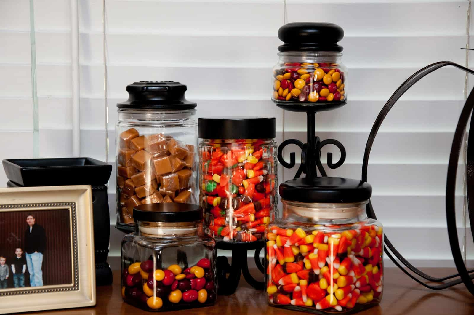 Halloween candy in old candle jars