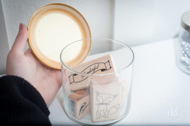 Reuse candle jars for craft storage