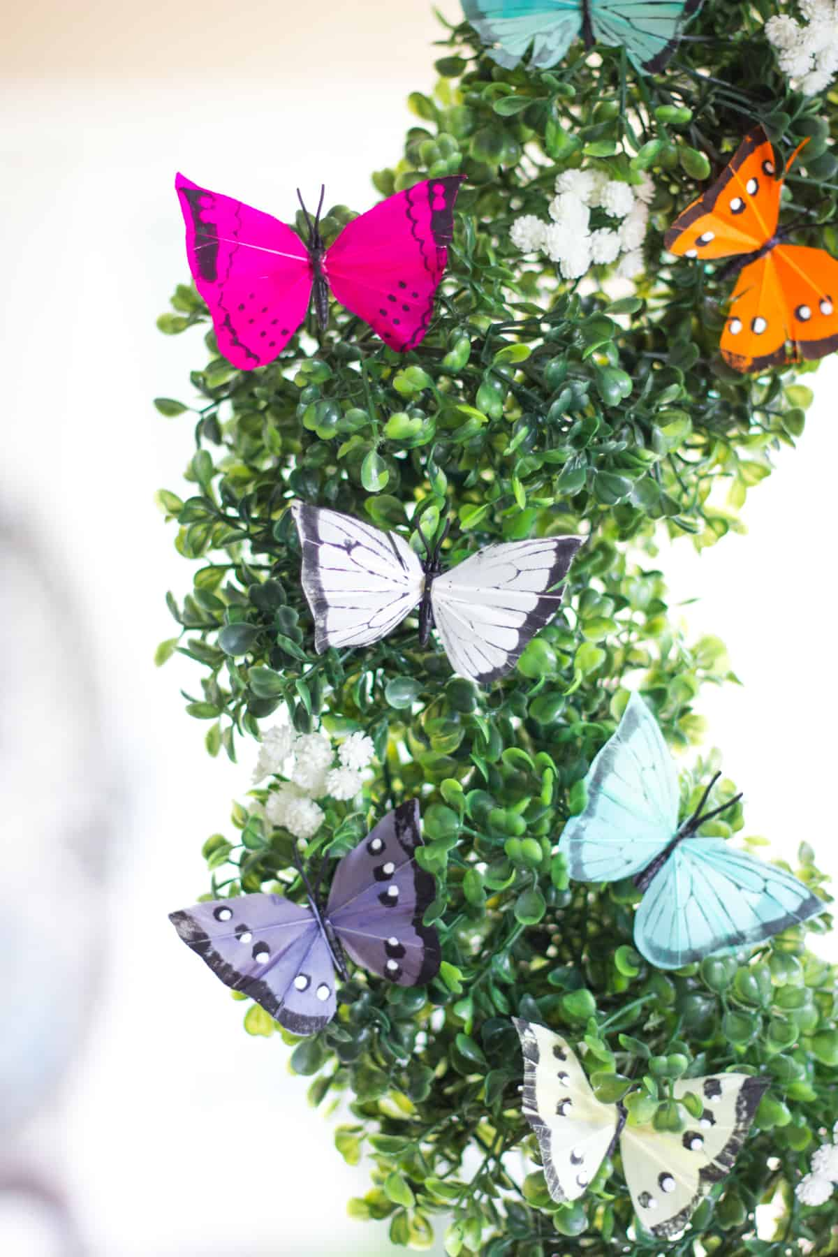 Butterflies and greenery wreath
