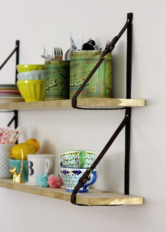 Leather straps hanging shelf
