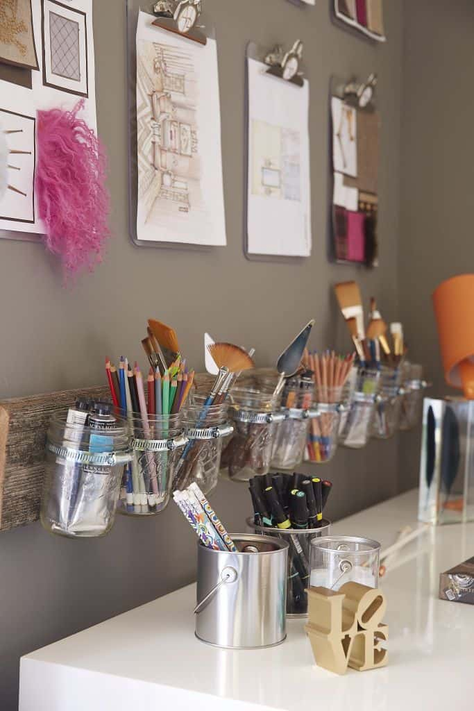 Mounted mason jars for art supplies