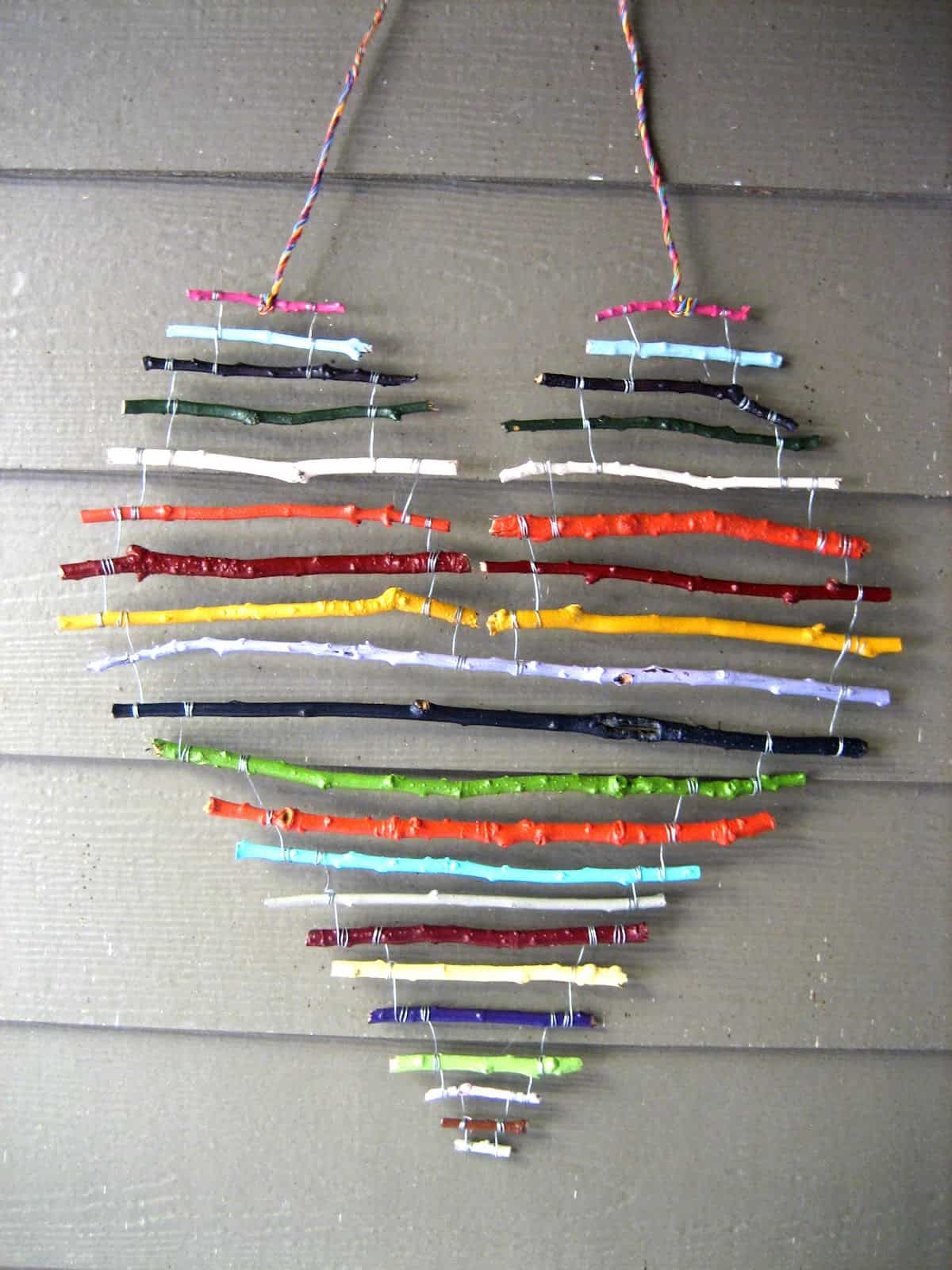 Painted horizontal twig heart mobile